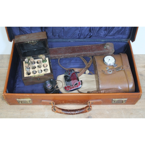 357 - A vintage case of assorted items including a Triumph car badge, chemist's bottles in wooden case, bi...