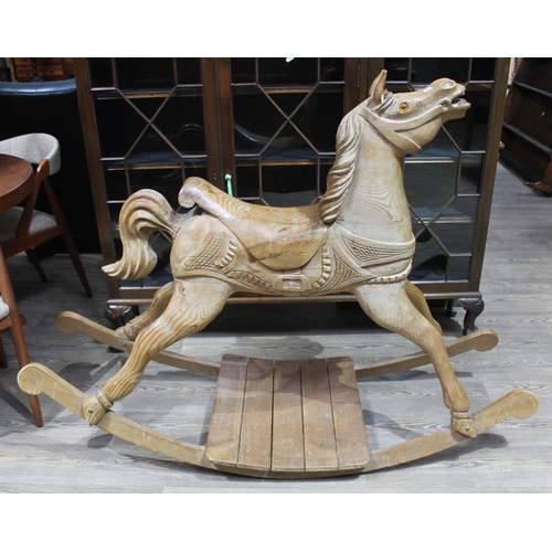 41 - A carved pine rocking horse, height 109cm, length 147cm, width 54cm....