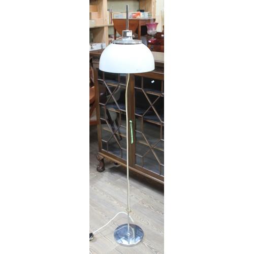 43 - A mid 20th century retro Harvey Guzzini chrome floor standing lamp with adjustable white plastic mus...