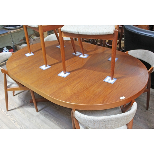 45 - A mid 20th century Danish teak round extending dining table with X frame footed pedestal base, toget...