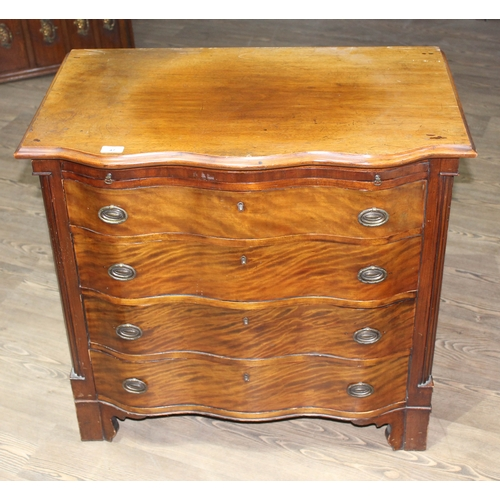 47 - A Georgian style mahogany bachelor's chest circa 1900, serpentine front with brass handles below a f...