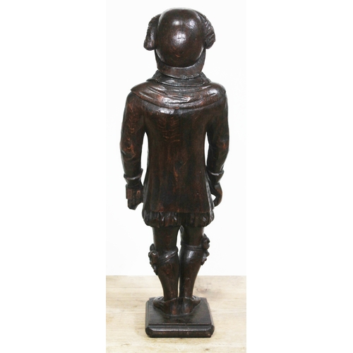 58 - A Victorian carved oak figure depicting a 17th century figure, height 64.5cm....