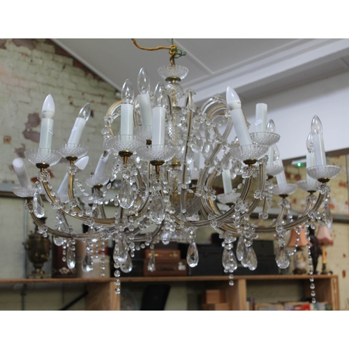 63 - A crystal and gilt metal chandelier, 20th century, diam. approx. 100cm....