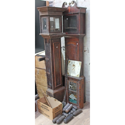 67 - Assorted clock spares comprising two long case clock cases, a painted dial, an American wall clock, ...