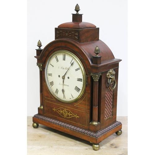 9 - A Regency brass inlaid mahogany bracket clock, domed top with brass finials, corinthian brass mounte...