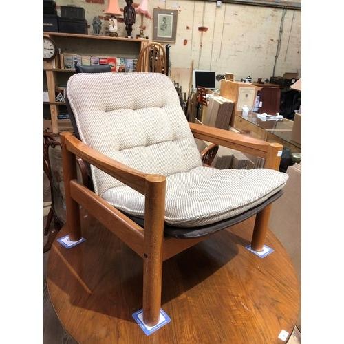 5 - A Danish teak lounge chair by Domino Mobler, width 71cm, depth 72cm & height 73cm....