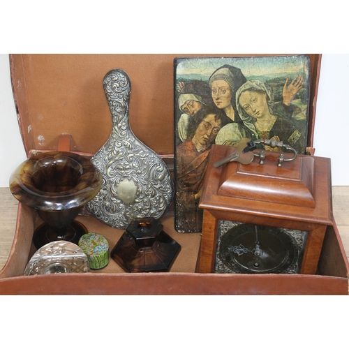 463 - A suit case and contents including a Smiths mantle clock, a print on board, an embossed mirror, a gl...
