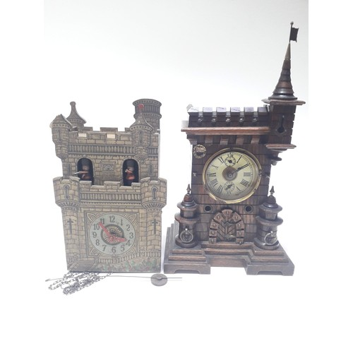 86 - Two novelty wall clocks formed as castles, one marked Paico England....