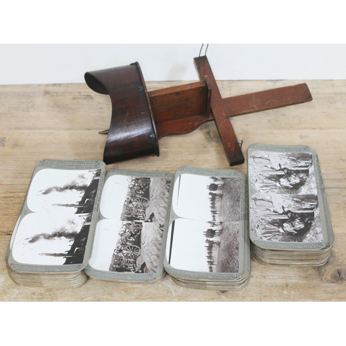 400 - A stereoscopic viewer and approx. 100 WWI slides published by Realistic Travels Publishers....