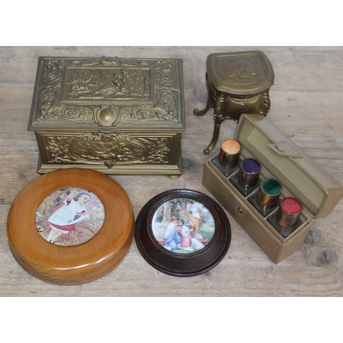 448 - A mixed lot comprising a cased set of enamel topped bottles, two metal trinket boxes and two pot lid...