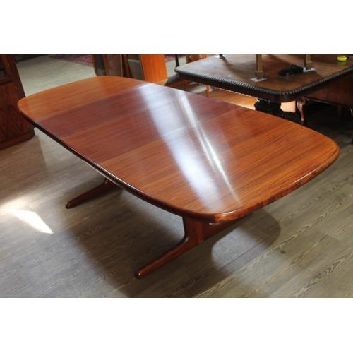 1 - A Danish Brazilian rosewood three piece dining room suite by Skovby Mobelfabrik comprising sideboard...