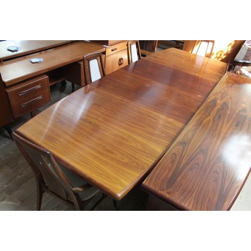 19 - A Danish Brazilian rosewood dining room suite by Skovby Mobelfabrik comprising sideboard having over...