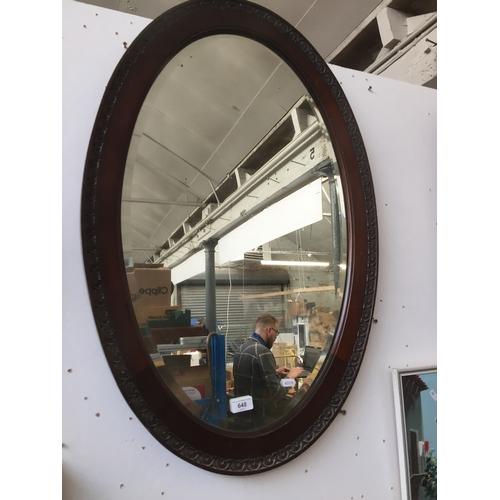 648 - A wooden framed mirror