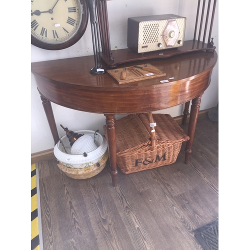 844 - A mahogany D end table on turned legs....