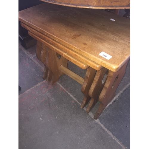 860 - An oak nest of three tables