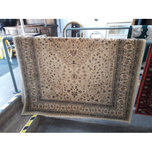 815 - A beige ground carpet 163cm x 230cm....