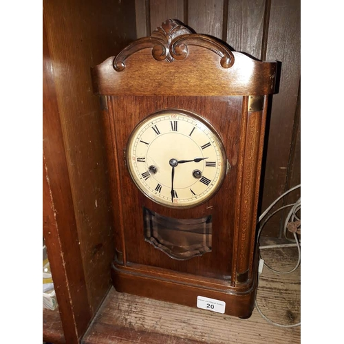 20 - A chiming mantle clock with pendulum and winder...