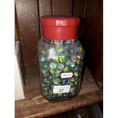 27 - A coffee jar full of marbles...