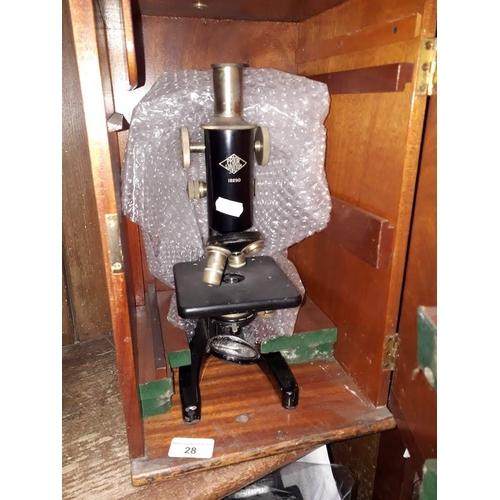 28 - A cased microscope - Prior, London, model no.18290...
