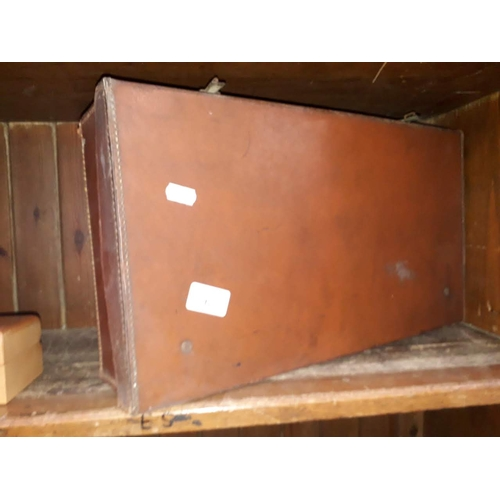 6 - A small vintage suitcase...