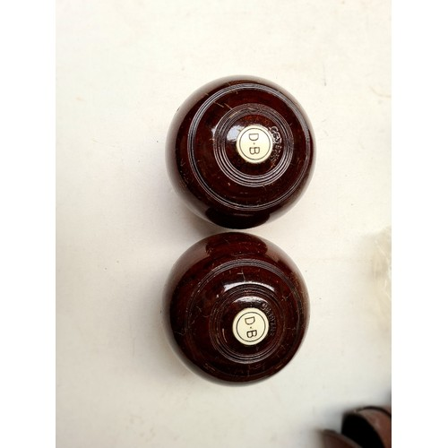 24 - 2 sets of crown green bowls, cased, bias 2 full...