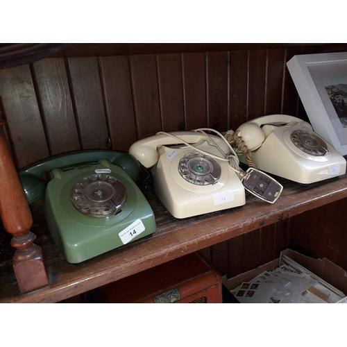14 - Three vintage telephones...
