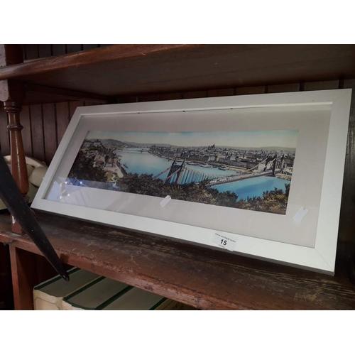 15 - A framed print of a river scene...
