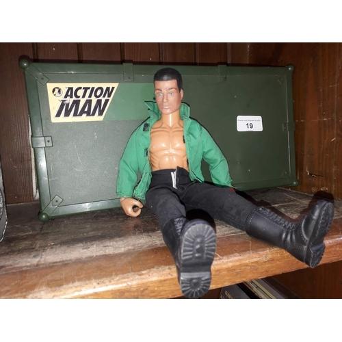19 - An Action Man figure in plastic box, with sub machine gun...