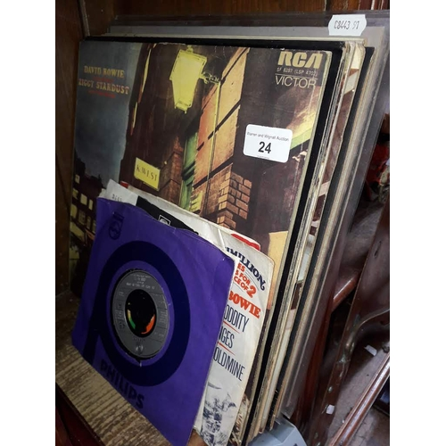 24 - A quantity of pop LPs and singles including Bowie, Beatles etc....