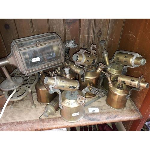 27 - Electric outside wall light lamp, six blow lamps, brass trivet...