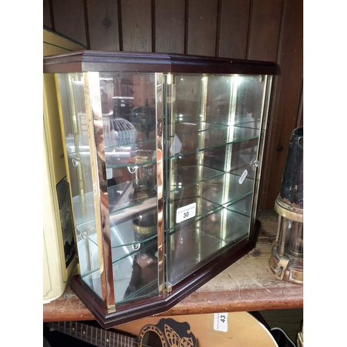 30 - A small glass display cabinet...