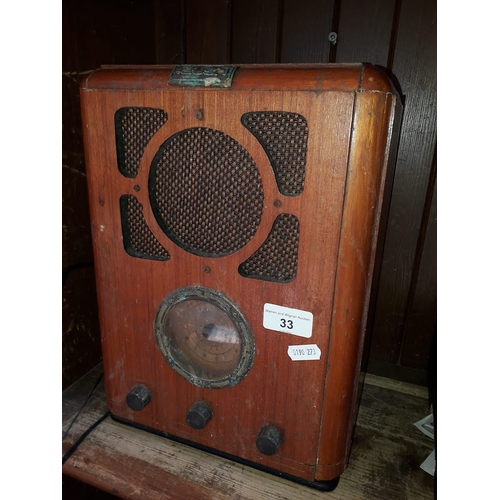 33 - A vintage radio and a horn handled walking stick