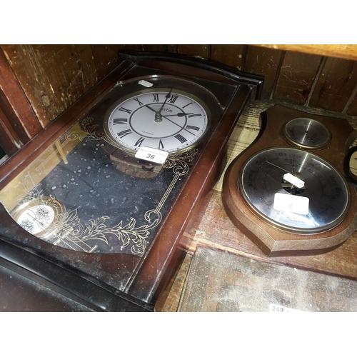 36 - An Acctim quartz wall clock and a barometer...