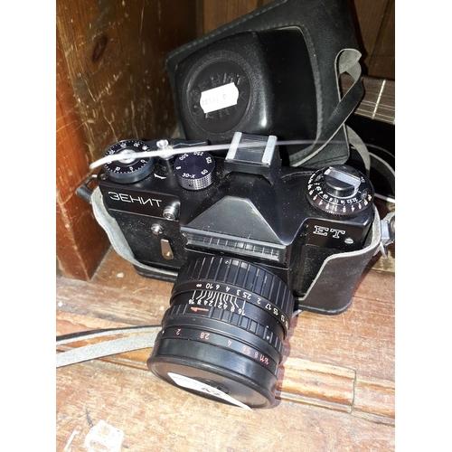 42 - A cased Russian Zenit 35mm camera...