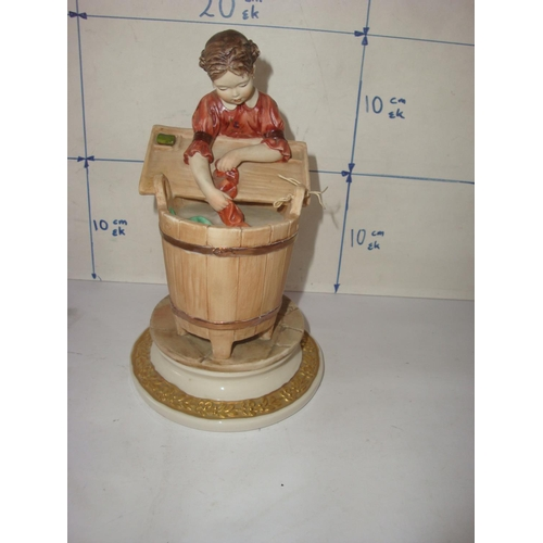19 - Crown 'N' Stamped Porcelain Figurine...