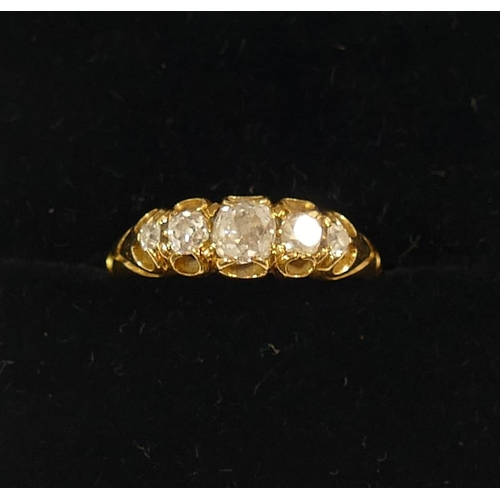 304 - A diamond five stone ring, the graduated old cut diamonds in claw setting, combined weight a approxi...