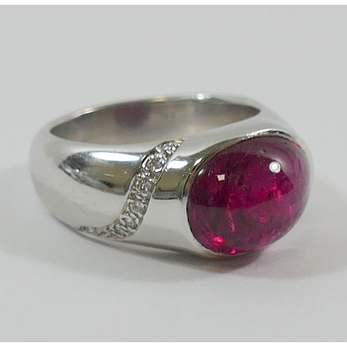 353 - An 18 carat white gold pink tourmaline and diamond ring, London 2000 with millennium hallmark by Nic...
