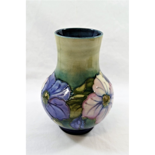 1 - A Moorcroft 'Clematis' pattern tubeline decorated baluster-shaped vase by Walter Moorcroft, impresse...