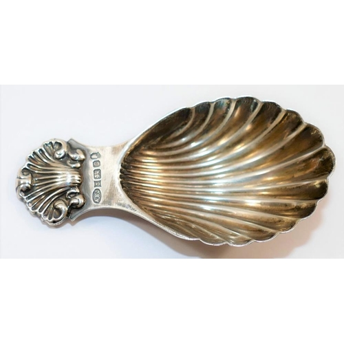 105 - A Victorian style silver caddy spoon with shell bowl and handle, Birmingham 1977 by A E Jones with j...