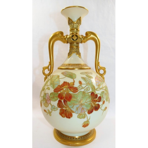 11 - A Royal Worcester porcelain two-handled vase, the ivory ground decorated with nasturtiums, outlined ...