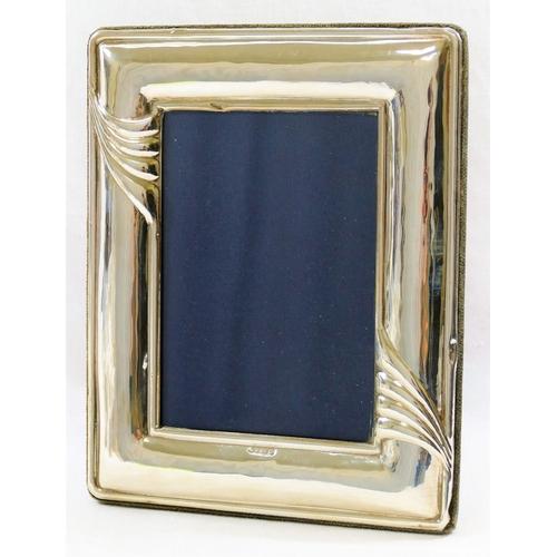 110 - A rectangular silver photograph frame, London 1996, 19.4cm x 15.5cm, with blue velvet easel back...