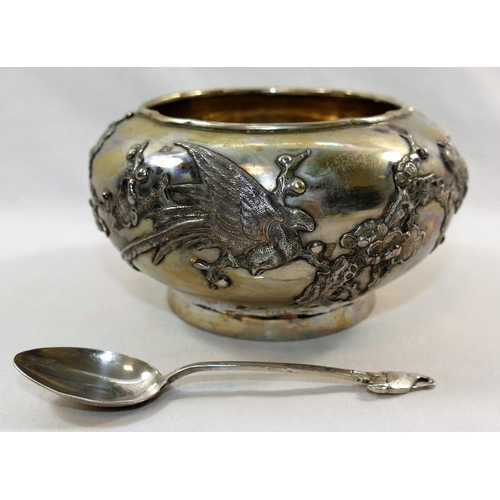 125 - A Japanese silver coloured metal sugar bowl, the sides of the bowl with raised decoration of birds a...