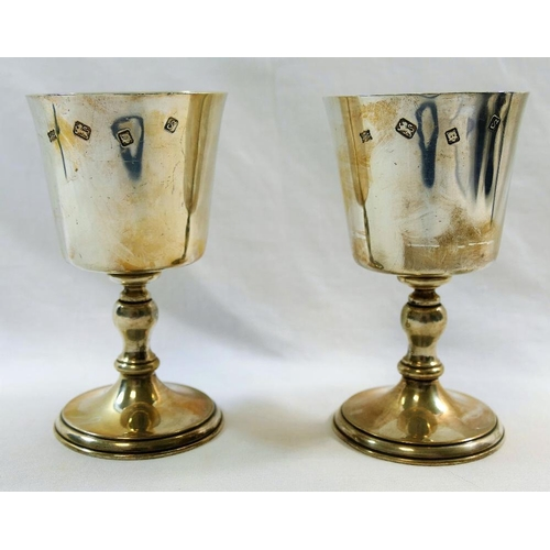 128 - A pair of silver goblets, London 1973, with baluster stems on rising circular foot, 12.4cm high, com...
