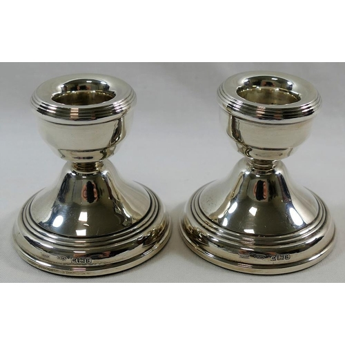 134 - A pair of squat silver candlesticks, Birmingham 1979, 5.7cm high, with loaded bases...