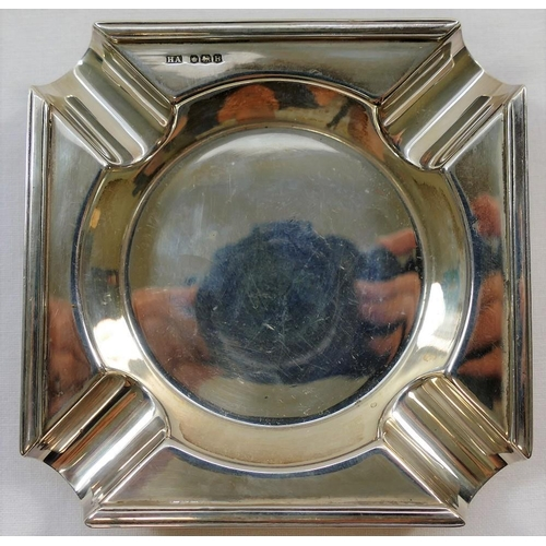 136 - A square section silver ashtray, Sheffield 1944, with cigarette rests to each corner leading to a ci...