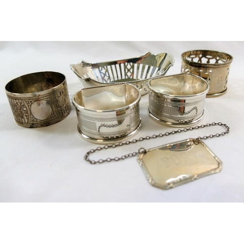 137 - A small oval silver dish, with pierced sides, 9.5cm long, a pair of D-shaped silver napkin rings wit...