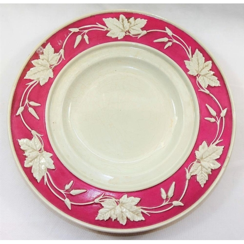 14 - A Victorian Copeland earthenware jardinere and stand, with pink ground and raised foliate decoration...