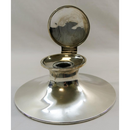 140 - A large silver capstan inkwell, initialed 'CW' to the lid, with glass well and loaded base, marks ru...