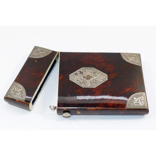 170A - A 19th century tortoiseshell and silver mounted hinged card case, 8.7cm x 5.3cm...