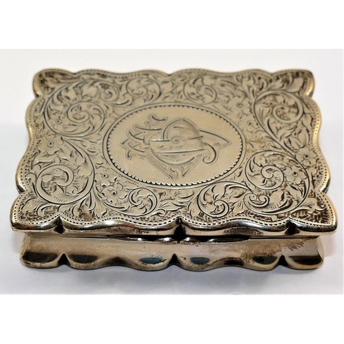 173 - A Victorian rectangular silver snuff box, Birmingham 1897 by Henry Charles Freeman, with wavy edges,...